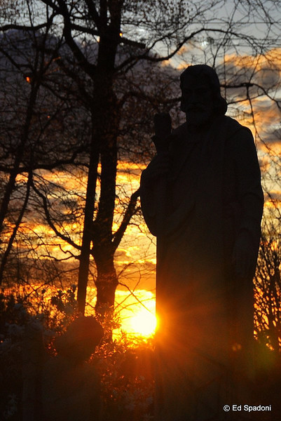 "St. Joseph<br /> 2/15/2010<br /> I was driving home, past St. Joseph's Cemetery when the setting sun behind this statue caught my eye, so I had to stop.  Another view can be seen here:  <a href=""http://bit.ly/b8Qc6k"">http://bit.ly/b8Qc6k</a>.  Which do you think is the better image?"