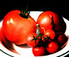 Red<br /> 9/6/2010<br /> The first harvest from our tiny tomato garden<br /> iPhone 3G