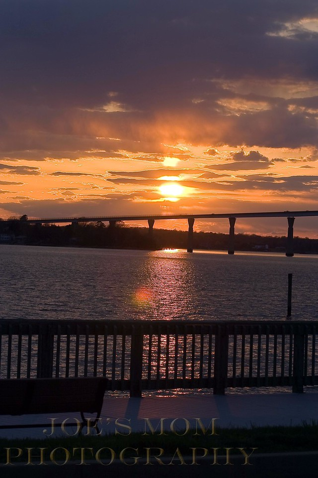 Sit on the bench and watch to sun go down---A view from the boardwalk on Solomons Island--a great place to watch the sunset.