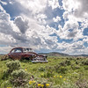 Jun 10 - Rust In The Meadow<br /> <br /> I loved the puffy sky, the old car, and the new wild flowers.  1947 chevy I think, Wyoming.