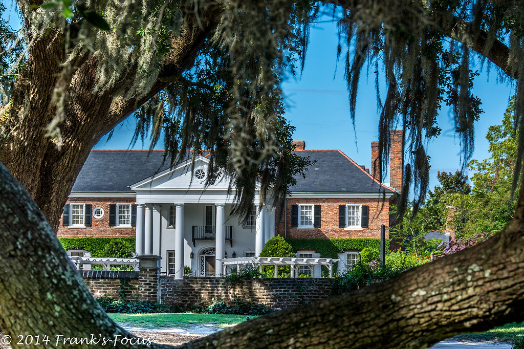 "March 5, 2014 -- Boone Hall Plantation House.  Near Charleston South Carolina, this plantation was founded in 1681 when Englishman Major John Boone came to Charleston and established a lucrative plantation and gracious home on the banks of Wampacheone Creek. <br /> <br /> <a href=""http://franks-focus.smugmug.com"">http://franks-focus.smugmug.com</a>"