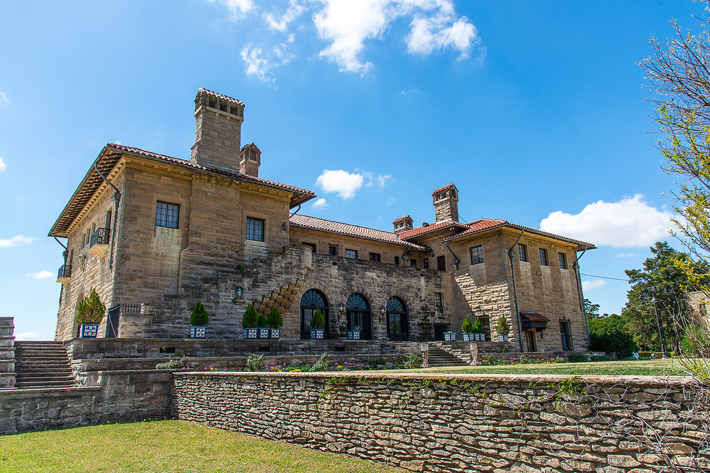 """This is a view of the rear of Marland Mansion in Ponca City, Oklahoma.  In my opinion, the rear is much more impressive than the front view, which will be tomorrow's daily post.<br /> <br /> The Marland Mansion is a 43,561 square feet (4,046.9 m2) Mediterranean Revival-style mansion located in Ponca City, Oklahoma. It contains a total of 55 rooms, including 10 bedrooms, 12 bathrooms and 3 kitchens.<br /> <br /> It was built by oil baron, politician, lawyer  and philanthropist Ernest Whitworth (E.W.) Marland, (May 8, 1874 – October 3, 1941) as a display of wealth at the peak of the 1920s oil boom, and is one of the largest residences in the southwestern United States, known as the """"Palace on the Prairie.""""  The mansion was constructed over a 3-year period (1925 – 1928), and heavily influenced by the Palazzo Davanzati in Florence, Italy which Marland had visited during his travels to Europe.<br /> <br /> E. W. Marland made & lost fortunes in the oil business in Pennsylvania and Oklahoma,  He was also a politician who served terms as a U.S. Congressman and Oklahoma governor. He was elected to the United States House of Representatives from northern Oklahoma in 1932 and as the tenth Governor of Oklahoma in 1934."""