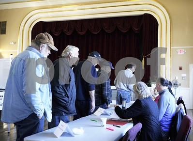 Robert Layman / Staff Photo  Voters wait to pick up their ballots during general election voting at West Rutland town hall Friday morning.
