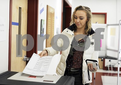Robert Layman / Staff Photo  Hannah Dicton of Castleton casts her ballot Tuesday morning at the Castleton Fire Department.