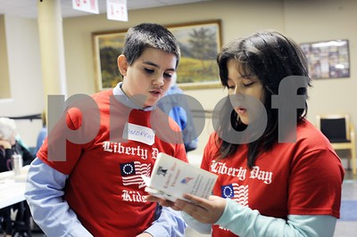 "Robert Layman / Staff Photo  Andrew Kenyon, left and Sophia Kopv of Neshobe School look over pocket sized versionof the Declaration of Independence and the US Constitution at the Brandon Town Hall Tuesday. The pair were part of ""Liberty Day Kids,"" a non-partisan organization created by The Lions Club whose goal is to celebrate the two fundamental doctrines. The pair, joined by their other class mate Brian Stanley handed out constitutions to voters after quizzing them on their Bill of Rights and their knowledge of the preamble."