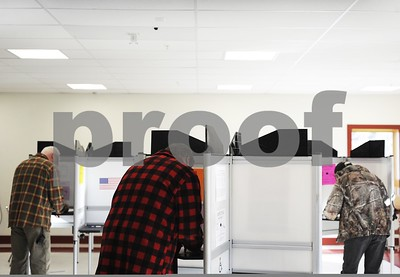 Robert Layman / Staff Photo  Nothing says Vermont more than flannel and camoflauge and it was especially in season on the voters during the general election at the Castleton Fire House Tuesday morning.