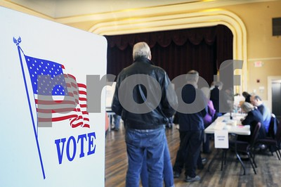 Robert Layman / Staff Photo  Voters wait to recieve their ballot at the West Rutland town hall Tuesday morning.