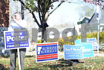 Robert Layman / Staff Photo  Dave Potter stands outside the Wallingford Town Hall waving to incoming voters Tuesday afternoon.