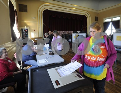 Robert Layman / Staff Photo  Virginia Smith casts her ballot at the West Rutland town hall Friday morning.