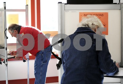 Robert Layman / Staff Photo  Voters vote at the Castleton Fire Department Tuesday morning.