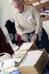 Robert Layman / Staff Photo  Justice of the Peace Bob Grace points to the absentee ballots that were returned for the general election at the Castleton Fire Department Tuesday morning. According to town clerk Nedra Boutwell, of the 435 ballots that were sent out, 390 were returned.