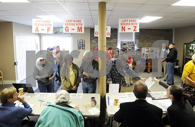 Robert Layman / Staff Photo  Voters check in at the Brandon town hall Tuesday morning.