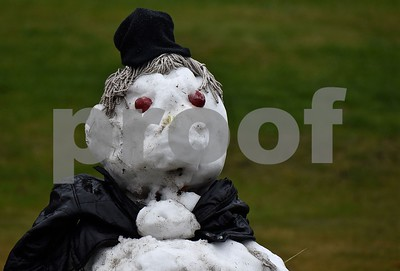 Photo by Jon Olender Much to his chagrin, this snowman weathers a patch of warm weather and rain on Tuesday afternoon in front of the Val Roc Motel in West Bridgewater.