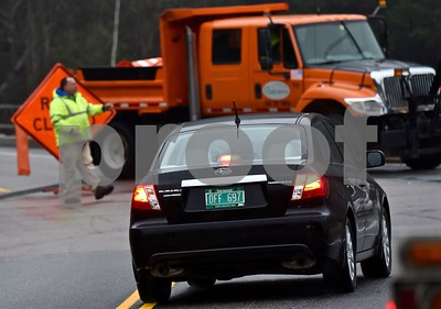 Photo by Jon Olender A VTrans worker directs traffic at the corner of Route 4 and 100A in West Bridgewater on Tuesday afternoon, hours after a fatal accident closed traffic between West Bridgewater and Bridgewater on Route 4 for hours.