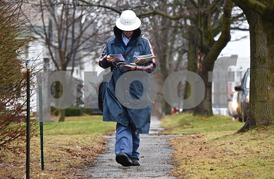 Photo by Jon Olender Postal carrier Adam Blackledge delivers the mail in inclement weather along Franklin Street in Brandon on Tuesday afternoon.