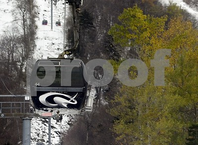 Robert Layman / Staff Photo  A K-1 Express gondola cab makes its way up the mile and a quarter trip to the top of Killington Ski Resort on the resort's opening day this past October.