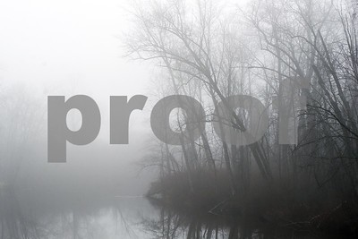 Robert Layman / Staff Photo  Wednesday morning's fog settles over the Otter Creek