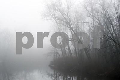 Robert Layman / Staff Photo  Wednesday morning's fog settles over the Otter Creek