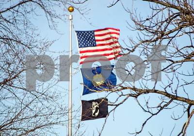 Robert Layman / Staff Photo The flags in Rutland's Main Street Park hold on tight during the chilling gusts of wind that blew through the area Thursday afternoon.