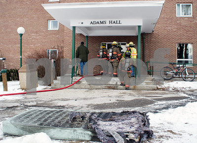 Robert Layman / Staff Photo A partially burned dorm mattress sits on the ground outside of Adam's Hall at Castleton University Thursday afternoon.