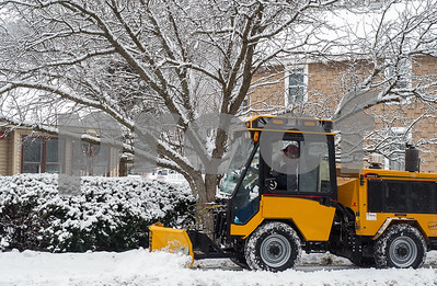Robert Layman / Staff Photo A small plow clears snow from the sidwalks alongside Marble Street in West Rutland Thursday morning.