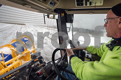 Robert Layman / Staff Photo  Mark Meszaros, mantainence worker at Rutland Southern Vermont Regional Airport, clears the 5,300 long, 100ft wide runway with the airport's Snow Mauler machine during Thursday's snowstorm.