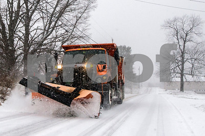 Robert Layman / Staff Photo A snow plow from the Vermont Department of Transportation makes its way down Route 7B in North Clarendon Thursday morning.
