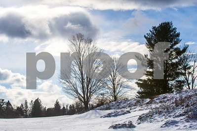 Robert Layman / Staff Photo Patches of blue sky are shown in the sky as the clouds part folowing yesterday's snowstorm, seen here at the Rutland Country Club.