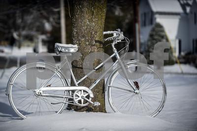 Robert Layman / Staff Photo A bike sits in the sunshine outside a home on Oak Street in Rutland Friday morning.