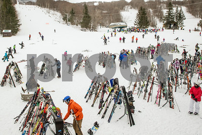 Robert Layman / Staff Photo Skiers and riders make their way to rack up their equipment on their way into lunch outside the Andrea Mead Lawrence Lodge at Pico Mountain Friday afternoon.
