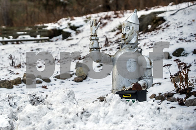 Robert Layman / Staff Photo The waving tinman statue at Pine Hill Park sits behind a waist-deep wall of plowed snow at the entrance to the trails Friday afternoon.