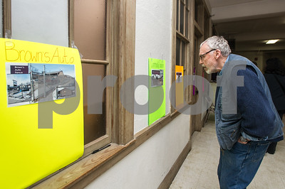 Robert Layman / Staff Photo Local artist and former Castleton professor Bill Ramage looks at the proposed locations for the art projects.