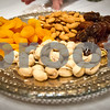 Robert Layman / Staff Photo A platter of almonds, dates, pitachios and apricots are typical fruit celebrated at Tu Bishvat ceremony.