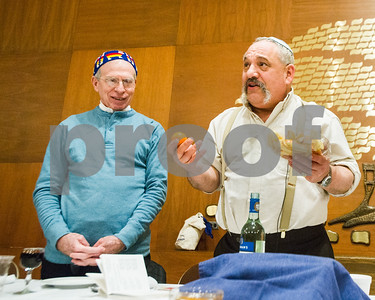 Robert Layman / Staff Photo For some comical effect Rabbi Doug Weber, right,  compares a bowl of apples to an orange, rousing a smile from Harvey Zara.