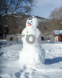 Robert Layman / Staff Photo A snowman soaks up the rays in West Rutland Friday morning.