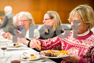 Robert Layman / Staff Photo Sharon Pickering picks an apricot off the platter.