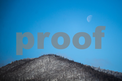 Robert Layman / Staff Photo The moon lowers down over a mountain top in Danby Friday morning.