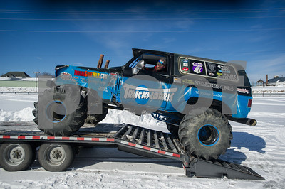 """Robert Layman / Staff Photo Randy Oakley carefully drives his monster truck dubbed """"Trucknorris"""" off the trailer at the Vermont State Fairgrounds inpreparation for the Vermonster Snowbog event Saturday morning."""