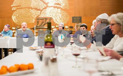 Robert Layman / Staff Photo Songs and prayers are sang at the table.