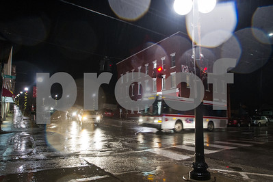 Robert Layman / Staff Photo As a wintry mix approaches the Rutland area, the roads become glazed over with a reflective sheen. Seen here a bus makes it's way through at the intersection of Wales and Center Street Tuesday night.