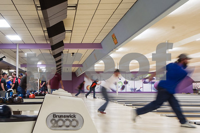 Robert Layman / Staff Photo In a slow exposure, a line of bowlers are seen in formation at the Rutland Bowlerama Tuesday night.
