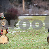 Robert Layman / Staff Photo<br /> Although the temperatures rose above average Wednesday which increased the snowmelt, these two snow statues at the town green in Proctor still had soem fun.