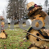 Robert Layman / Staff Photo<br /> Robert Layman / Staff Photo<br /> Although the temperatures rose above average Wednesday which increased the snowmelt, these two snow statues at the town green in Proctor still had soem fun.