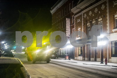 Robert Layman / Staff Photo A snow plow from the Rutland City Department of Public Works scatters the road with gravel during Tuesday night's snowfall.