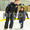 Robert Layman / Staff Photo Sgt. Charlie Whitehead skates around the rink at Giorgretti Arena Wednesday morning with Northwest Elementary School second grader Quinlan Fitzsimmons. The school wrapped up their six week learn-to-skate Wednesday with help from the city police Department, Rutland City Fire Department and members of the Castleton University hockey team.