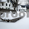 Robert Layman / Staff Photo A park bench on the village green in Pittsfield serves as a visual guage for the amount of snow fallen in recent storms.
