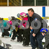 Robert Layman / Staff Photo Chris Greene, School Resource Officer for the Rutland City district dances with Northwest Elementary school students on the rink at Giorgetti Arena Wednesday morning. The school wrapped up their six week learn-to-skate Wednesday with help from the city police Department, Rutland City Fire Department and members of the Castleton University hockey team.
