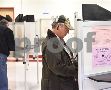 Photo by Jon Olender Castleton resident Sal Cintorino votes on Tuesday afternoon at the Castleton Public Safety Building.