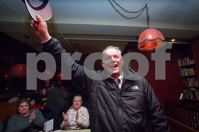 Robert Layman / Staff Photo Dave Allaire cheers to a crowd of people at Kelvan's restaurant Tuesday night following his win in the Rutland City Mayoral race.