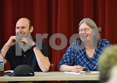Photo by Jon Olender Selectboard member Sam Bartholomew and Town Clerk and Treasurer Daphne Bartholomew share a laugh during Tuesday's Town Meeting in Benson.
